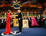 Gerard Mourou and Donna Strickland receiving Nobel Prize 2018